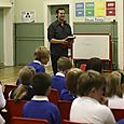 Author Dan Freedman reads from 'Kick-Off' to children from Trinity and Denholm primary schools